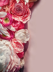 beautiful background of flowers and place for text on pink texture