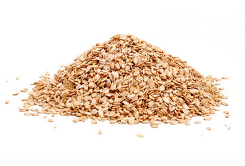 Heap golden oat flakes isolated on white background. Close up, high resolution product.