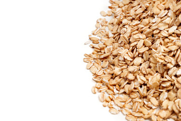 Golden oat flakes on white background. Close up, top view, high resolution product