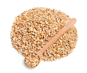 Heap of oats and spoon on white background. Diet, healthy food. Close up, top view, high resolution product
