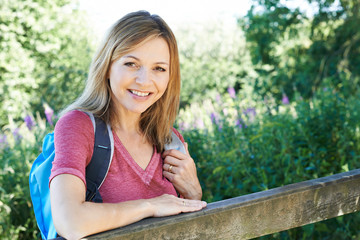 Portrait Of Mature Woman Hiking In Countryside