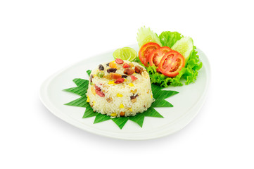 Rice with vegetables and fruit in white plate isolated