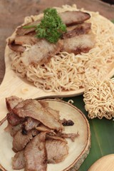 Instant noodles at blanched with baked pork delicious.