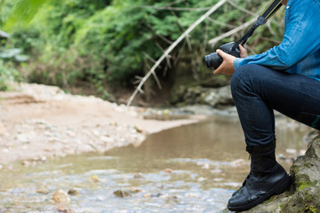 Man is hiking outdoor with river and take picture concept Lifest