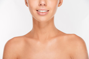 Cropped image of woman with skin care looking at camera