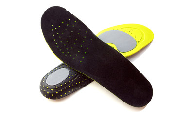 Orthopedic insoles for athletic shoes