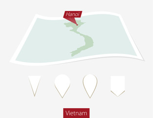 Curved paper map of Vietnam with capital Hanoi  on Gray Background. Four different Map pin set.