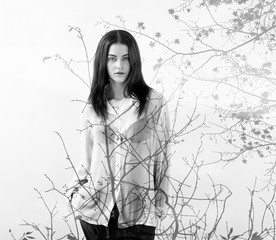 Monochrome double exposure of beautiful girl portrait and autumn tree branches