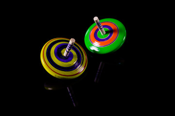 Gyroscopes toy on black background.