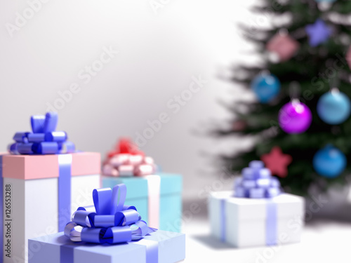real christmas tree with gifts present box with colored ribbon and bow on clean white blurred