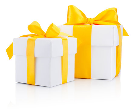 Two white gift boxs tied a yellow satin ribbon bow Isolated on w