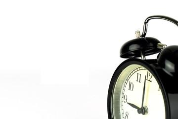 Alarm Clock on white, showing nine o'clock