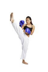 Female boxer with one leg raised