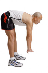 Young man bending over doing stretching exercise