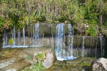 Mountain spring waterfall the azure river. Georgia