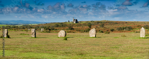 Part of the Hurlers Stone Circle with an abandoned mine building near Minions in Bodmin Moor in Cornwall.