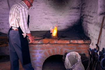 Fire sparks maintain blacksmith
