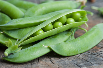 pods green pea on an old wooden table