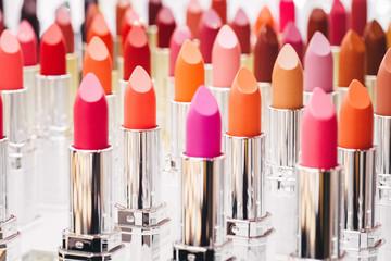 Set of color lipsticks on white background