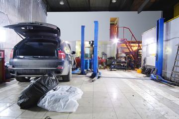 Car under repair in a car repair station