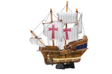 Toy sailing ship on a stand isolated on a white background