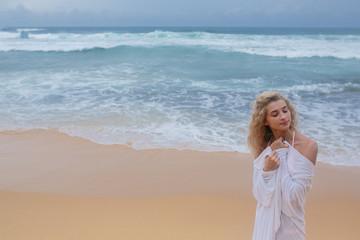 Beautiful young woman on beach