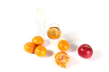 ripe apple, tangerine and glasses with alcohol