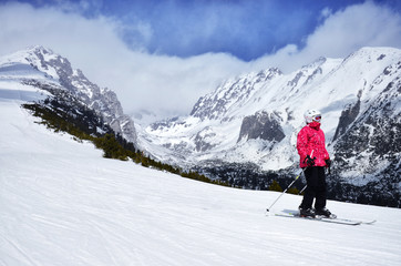 Skier on the track - winter scenery in mountains