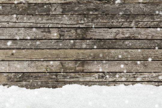 snow on a wooden fence as background image