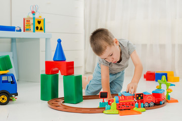 baby playing on the floor in a locomotive
