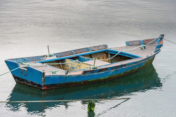fishing boat anchored on the docks