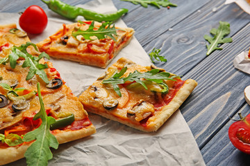 Delicious pizza slices on parchment