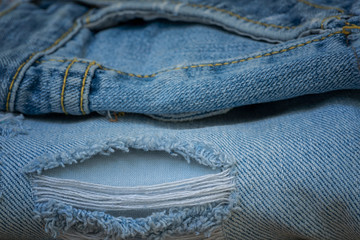 Closeup a hole of old jean, Worn old jean