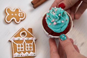 Christmas cupcake in female hand.