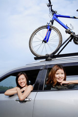 Women looking out of car window, smiling