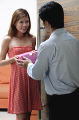 Man giving woman a present