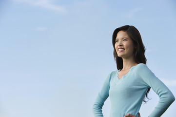 Woman smiling while looking into the distance
