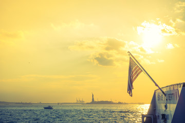 American flag with Statue of Liberty, New York City , USA .  ( F