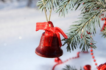 red bell on a branch