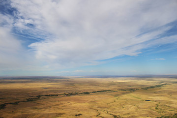 Flat expanse of the Great Plains seen from atop Bear Butte in South Dakota.