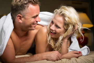 Woman flirting with her man in bedroom