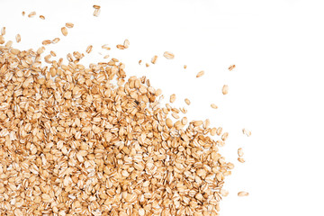 Oat flakes scattered on white background. Copy space, high resolution product