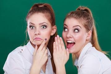 Two teenagers shares secrets, gossip
