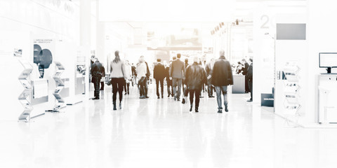 blurred business people trade fair stock photo