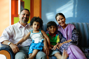 Family with two children, smiling at camera