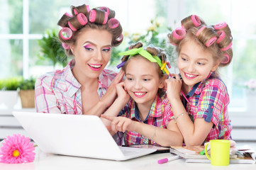 Mother and daughters  with laptop