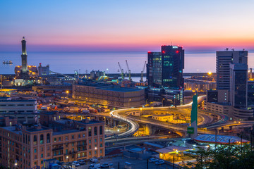 GENOA, ITALY OCTOBER 30, 2016 - Industrial area near the port with Lanterna and commercial skyscrapers at sunset