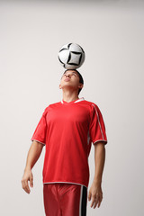 Soccer player with ball on head