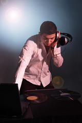 Young man working as DJ