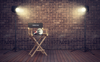 Film director's chair with megaphone and spotlights. 3D renderin